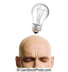 isolated lamp and bald man with close eyes, focus point on face