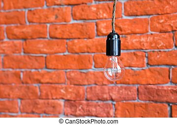 Idea concept - incandescent bulb on wall background