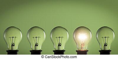 Idea concept. Light bulbs on green background