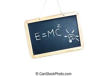 idea concept with bulb light and energy formula on school blackboard