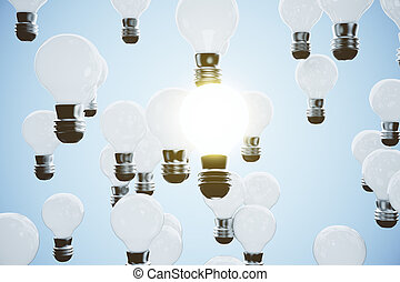 Idea concept with glowing light bulb on a blue background