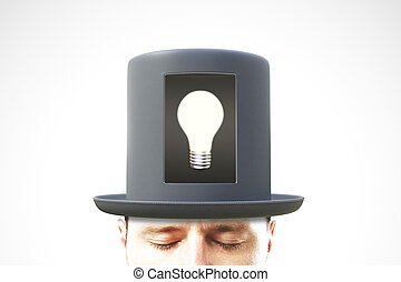 Idea concept with man head in black cylinder with white light bulb in the center
