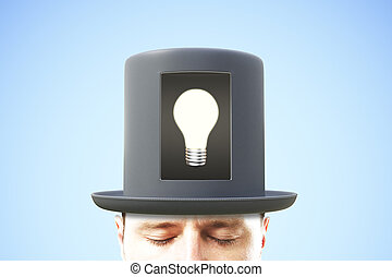 Idea concept with man in black cylinder and glowing light bulb in the center