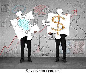 Idea is money concept on puzzles with men holding in office