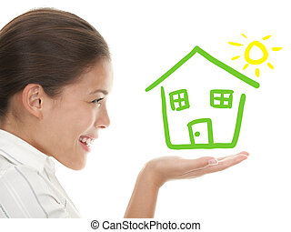 Happy house buyer / owner concept or woman dreaming of a house. Illustration and photo composit. Mixed chinese caucasian woman in profile isolated on white background.