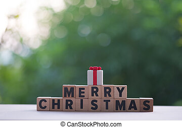 Idea of Merry Christmas spelled out of stacked wood block letters
