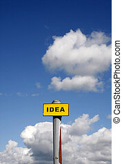 Idea sign against a blue sky