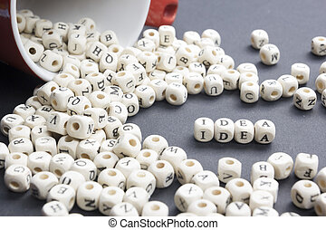 IDEA word formed by wood alphabet blocks. Wooden ABC