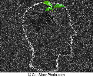 idea young growth inside of human head contour on asphalt concept