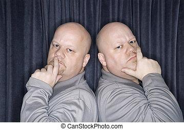 Identical twin men. - Caucasian bald identical twin men ...