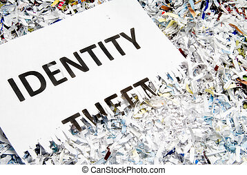 Identity theft - A shredded document with Identity Theft...