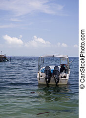 Idle Boat at Sea - Image of a boat at sea.