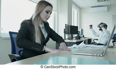 Idleness in the office workers rest. A girl is doing an...