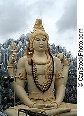 Idol of Lord Shiva sitting in placid mood