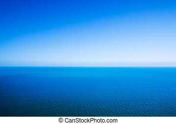 Idyllic abstract background - horizon line between calm sea...