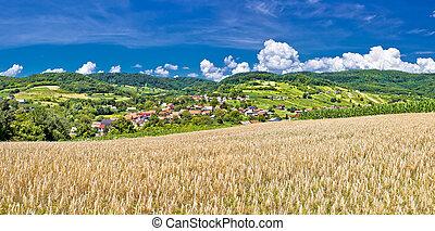Idyllic agricultural landscape of Kalnik mountain, village...