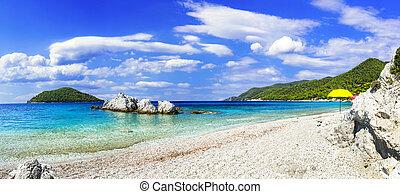 White sand, turquoise sea and mountains in Kastani beach, Skopelos island, Greece.