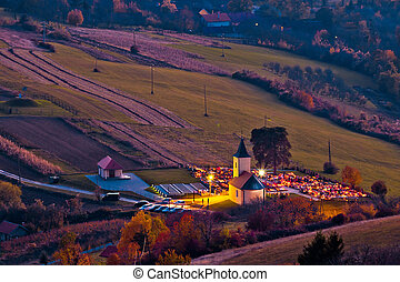 Idyllic church and graveyard evening view from above,...