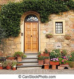idyllic door - entrance to the house in Tuscany, Italy,...