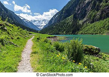 Idyllic excursion destination scenic in summertime in the Alps, near Stillup Lake, Zillertal Alps Nature Park, Austria, Tyrol