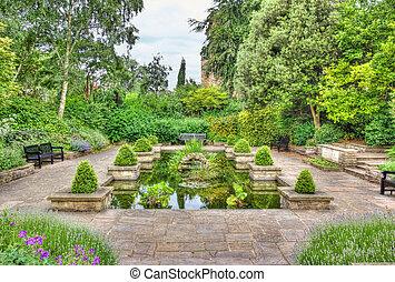 Idyllic garden with pond