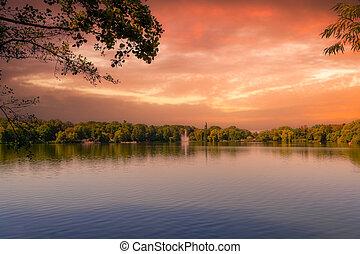 idyllic lake in the sunset in summer