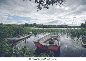 Idyllic lake with a small boat