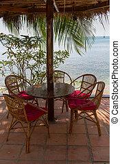 Idyllic outdoor cafe over looking the ocean