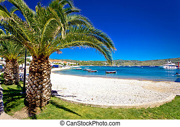 Idyllic palm beach in Primosten, Dalmatia, Croatia