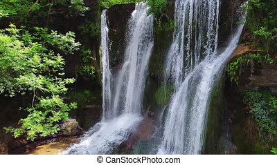 Idyllic rain forest waterfall, stream flowing in the lush ...