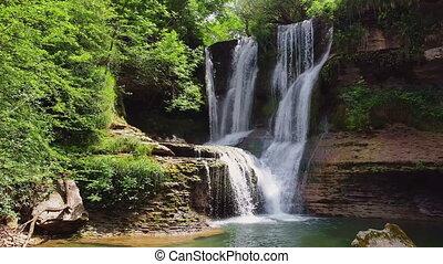 Idyllic rain forest waterfall, stream flowing in the lush ...
