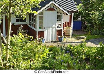 Idyllic red cottage