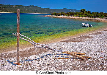 Idyllic rocky beach Sakarun and small boat on Dugi Otok island, archipelago of Dalmatia, Croatia