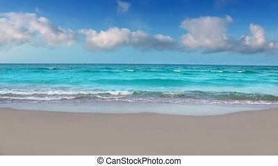 idyllic shore beach with turquoise tropical water and white sand