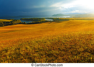 Idyllic summer landscape with clear mountain lake and green...