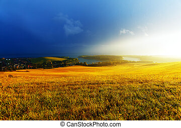 Idyllic summer landscape with lake and green and yellow...