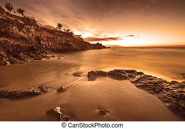 Idyllic sunset in the beach, Playa de la Arena, Tenerife, Spain.
