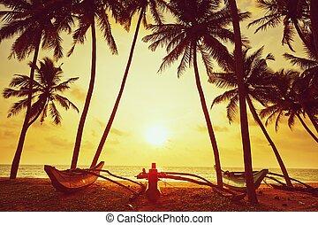 Idyllic sunset on the beach near Hikkaduwa in Sri Lanka