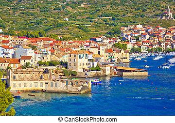 Idyllic town of Komiza on Vis island summer view
