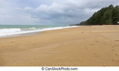 Idyllic tropical turquoise beach with white sand shore at andaman sea Phuket beach Thailand