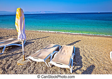 Idyllic turquoise beach parasol and deck chair, Zlatni Rat,...