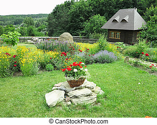 idyllic view of small house on a background of flowers and green forest