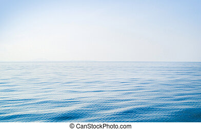 Idyllic view of the ocean and sky. Blue sea background.