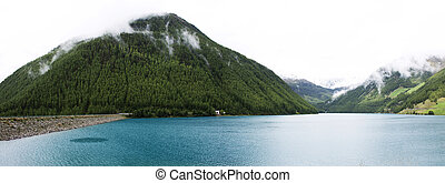 iew landscape of Apls mountain and Fedaia Lake is a lake in Trentino-Alto Adige