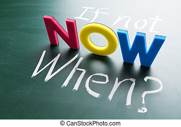 If not now, when? Colorful words on blackboard.