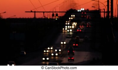 ight Traffic On Freeway under Red Sunset Sky