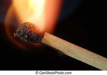 Igniting match - Close-up of igniting match isolated on...