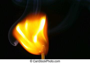 Igniting Match - Closeup of a red-tipped wooden match stick ...