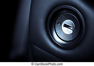 Close up shot of the ignition keyhole in a car