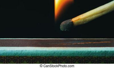 Ignition Match on Matchbox. Macro shot of a match igniting...